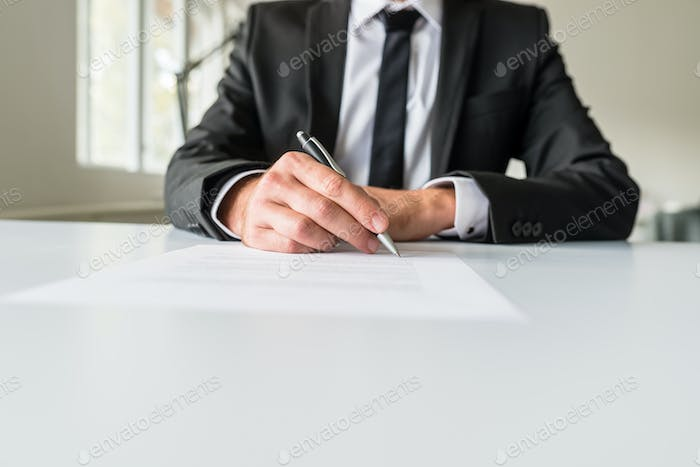 Business employer signing paperwork