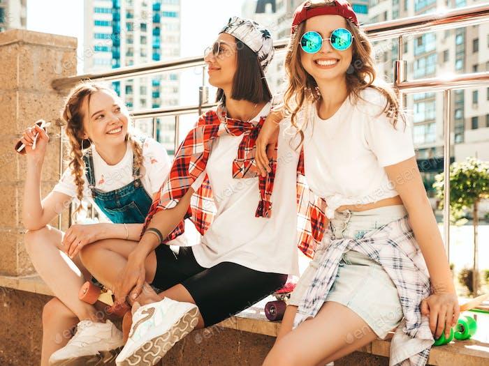 Portrait of three funny women posing outdoors