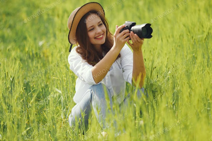 Woman shooting in a summer field