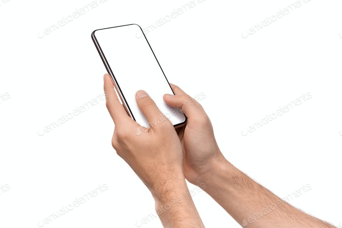 Man's hands texting on smartphone with blank screen
