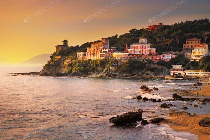 Castiglioncello sunset on cliff rock and sea. Tuscany, Italy.
