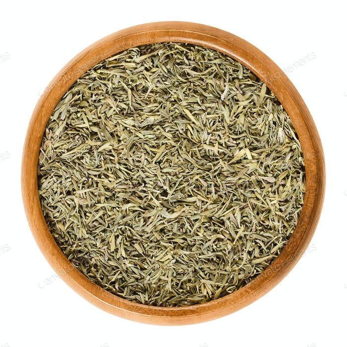 Dried minced thyme in wooden bowl over white