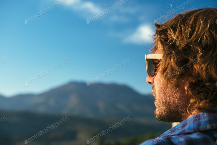 Handsome man in sunglasses posing