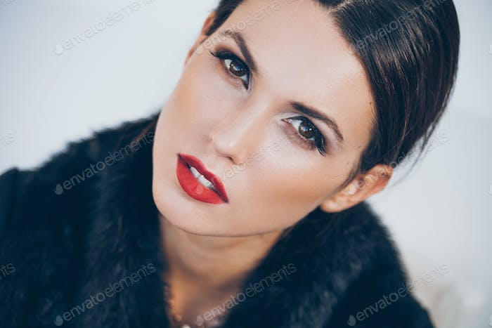 Woman with brown eyes and red lipstick