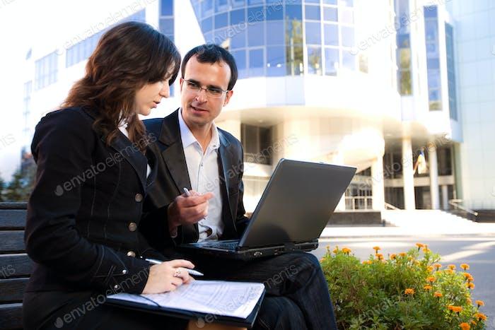 Man and woman looking at laptop screen