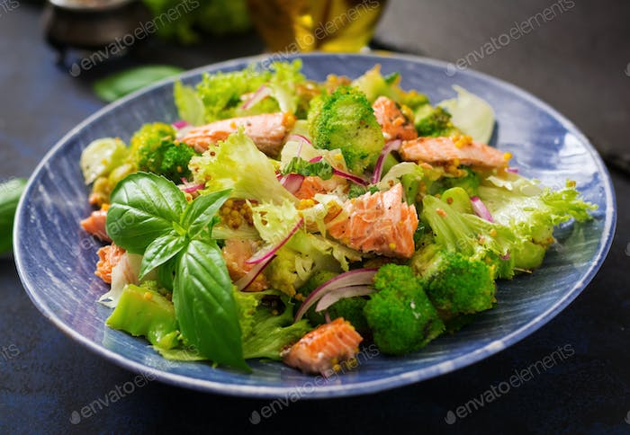 Salad of stewed fish salmon, broccoli, lettuce and dressing.