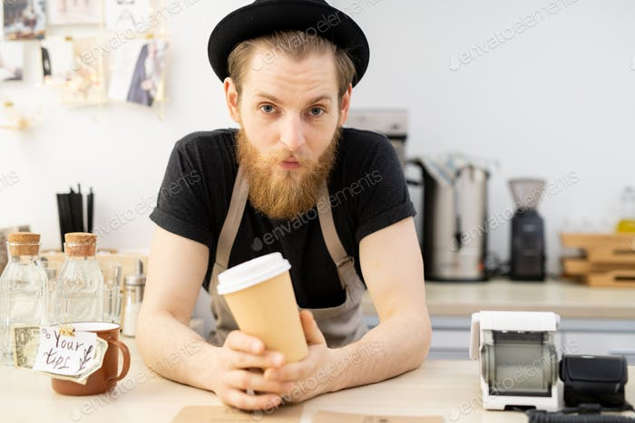 Handsome barista in hat