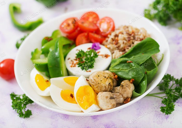 Oatmeal porridge, egg and fresh vegetables - tomatoes, spinach, paprika,  mushrooms