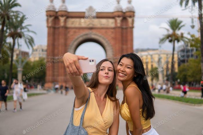 Travelling girlfriends taking selfie during sightseeing