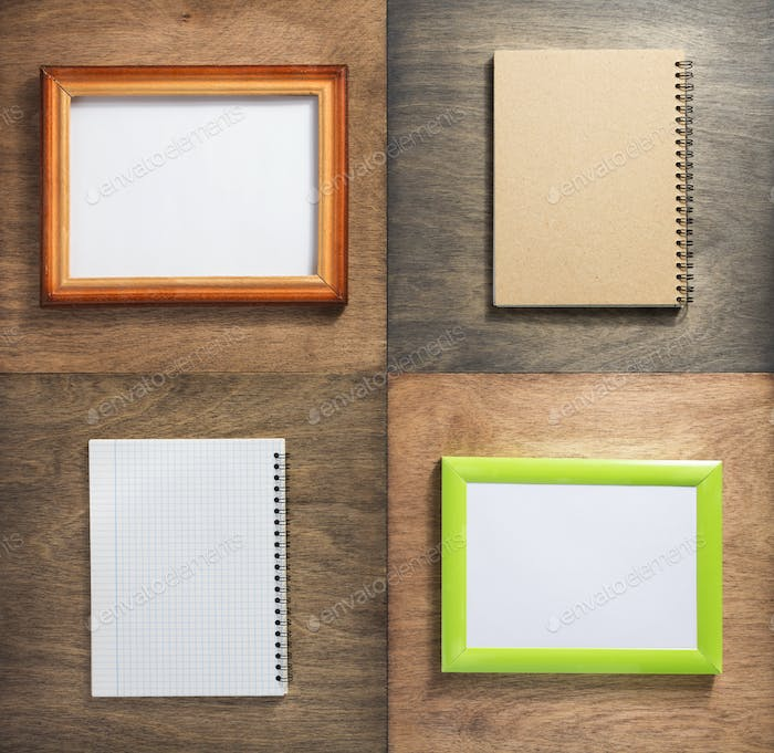 checked notebook and picture frame at wooden background