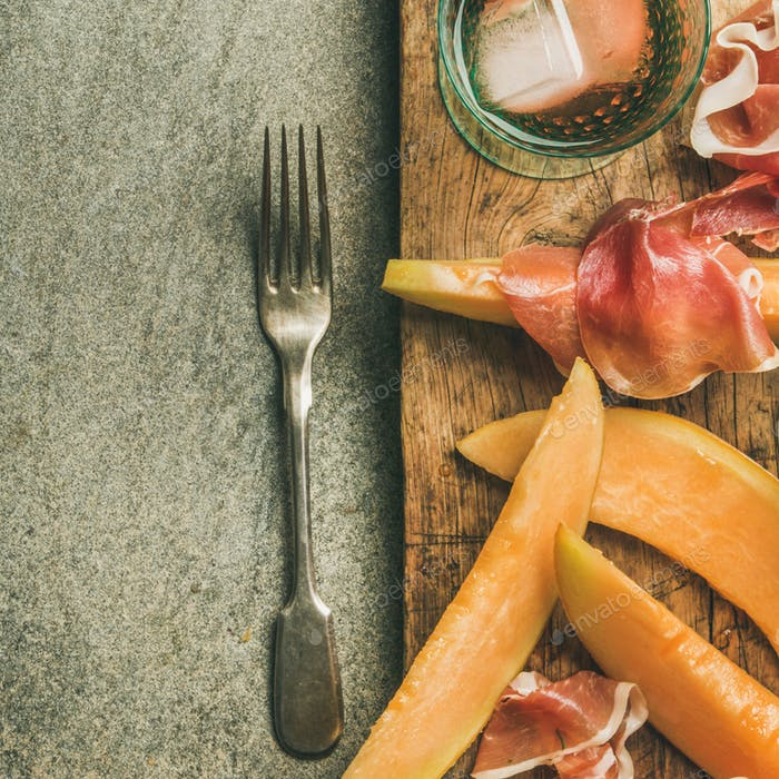 Summer wine party set with rose wine, prosciutto on board