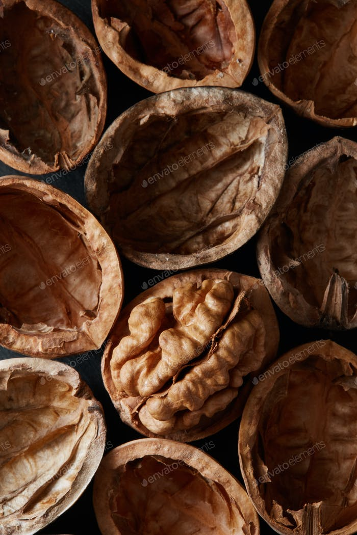 Macro close-up crop of walnuts shells as food backdrop composition