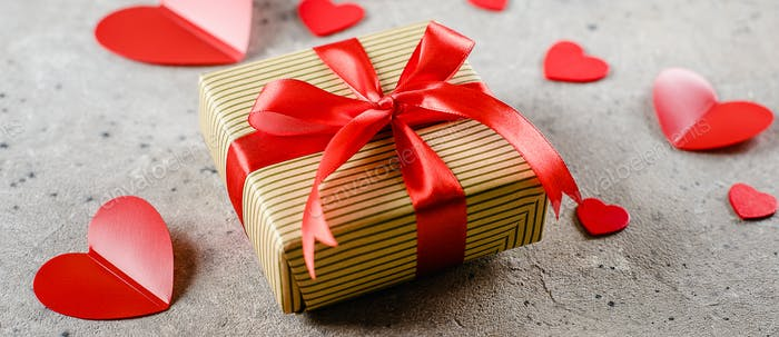 Gift Present box with red ribbon, red hearts. Valentine's Day concept. Banner for design, website