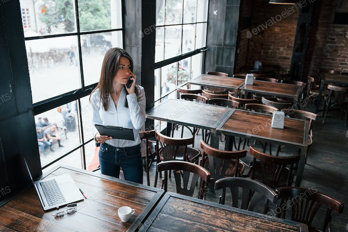 Worried look. Businesswoman in official clothes is indoors in cafe at daytime