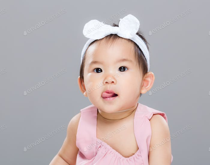 Asian baby girl show tongue