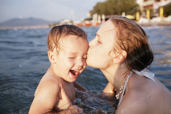 Mother kissing her young child