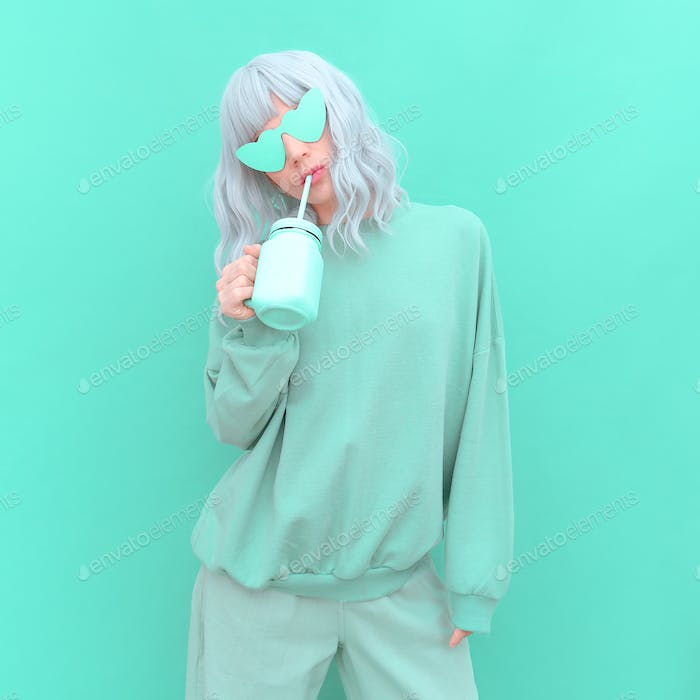 Aesthetic girl in stylish accessories sunglasses and fresh Smoothie. Mint monochrome colours design