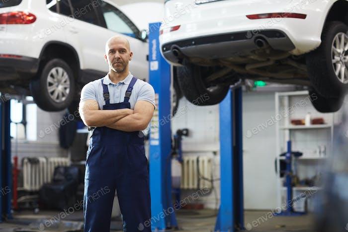 Muscular Mechanic in Auto Shop
