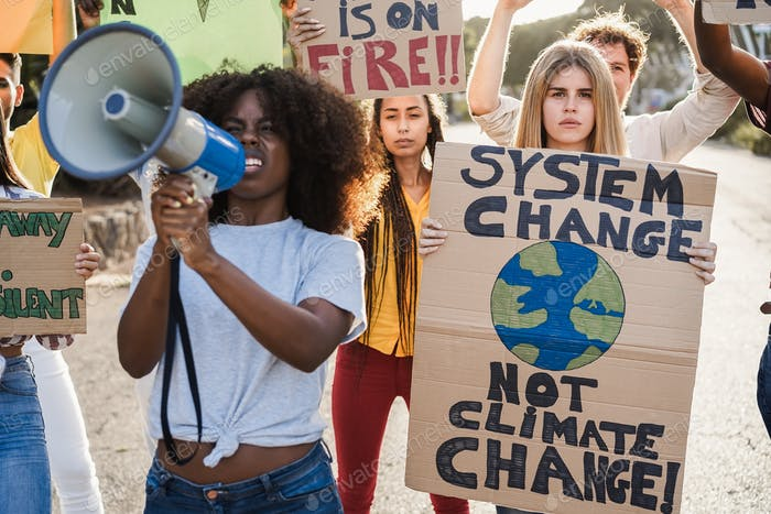 Young group of demonstrators on road from different culture and race fighting for climate change