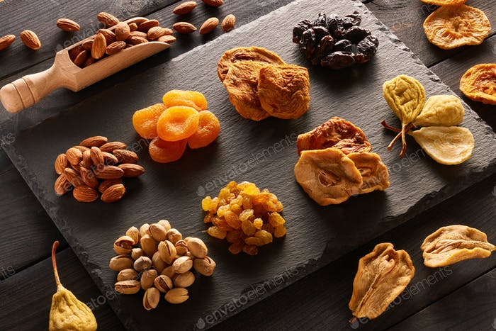 Dried fruits and nuts on slate plate