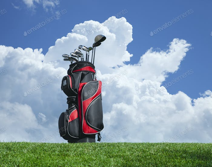 Red Golf Bag and Clubs on a Hill with Clouds and Sky