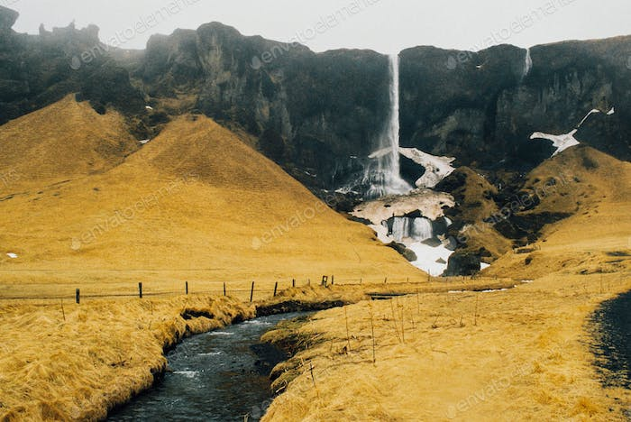 Waterfall into the Yellow Grass