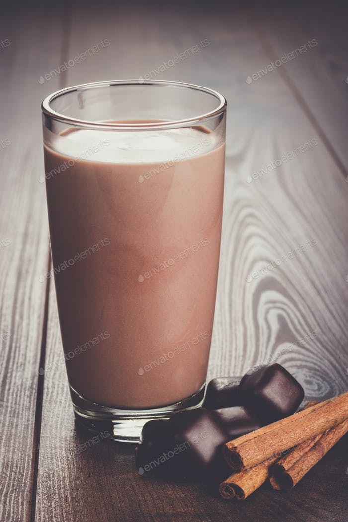 glass of chocolate milkshake and cinnamon