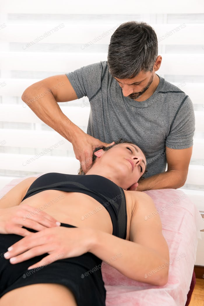 Osteopath performing cervical trust therapy