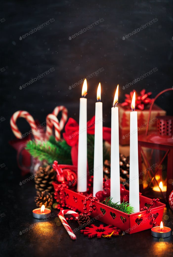 Thumbnail for Four Christmas Advent candles and holiday decorations around on