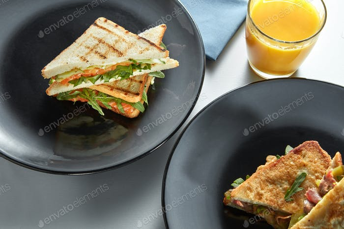 delicious breakfast sandwiches and orange juice