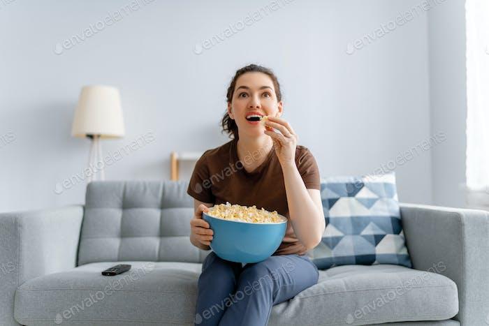 Young woman watching  TV