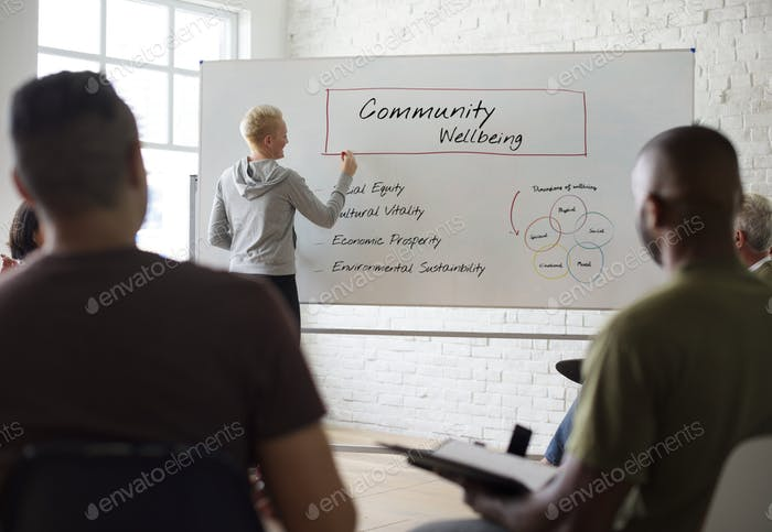 Woman writing on board in seminar