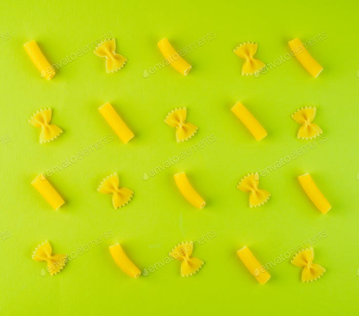 pattern of pasta on green background, food ingredient, top view