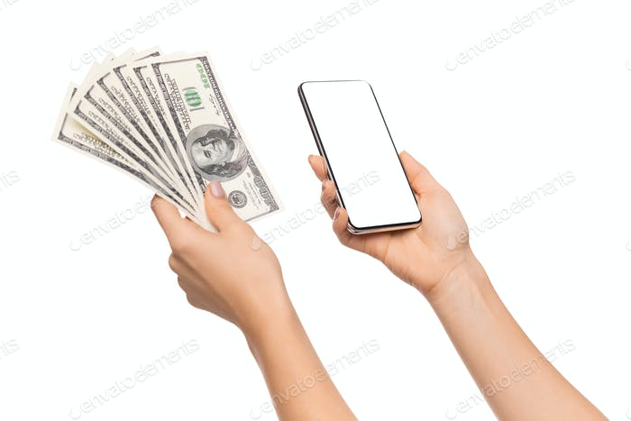 Female holding bunch of dollars and smartphone with blank screen