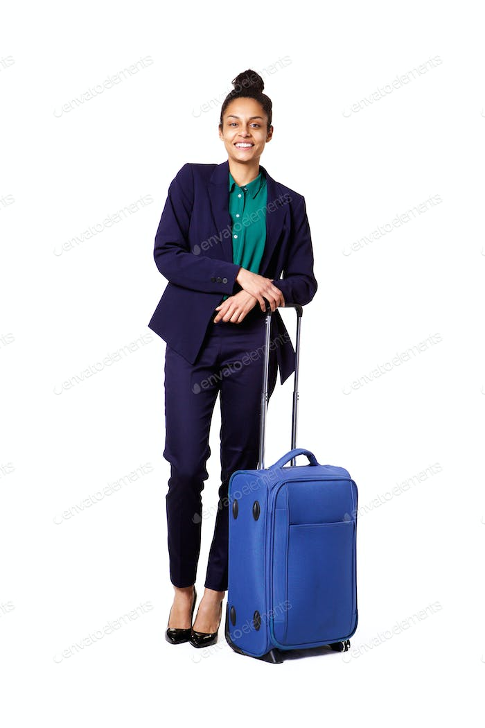 Beautiful young businesswoman standing with travel bag