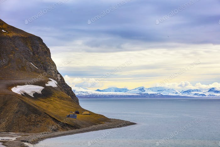 Houses and mountains in arctic summer landscape