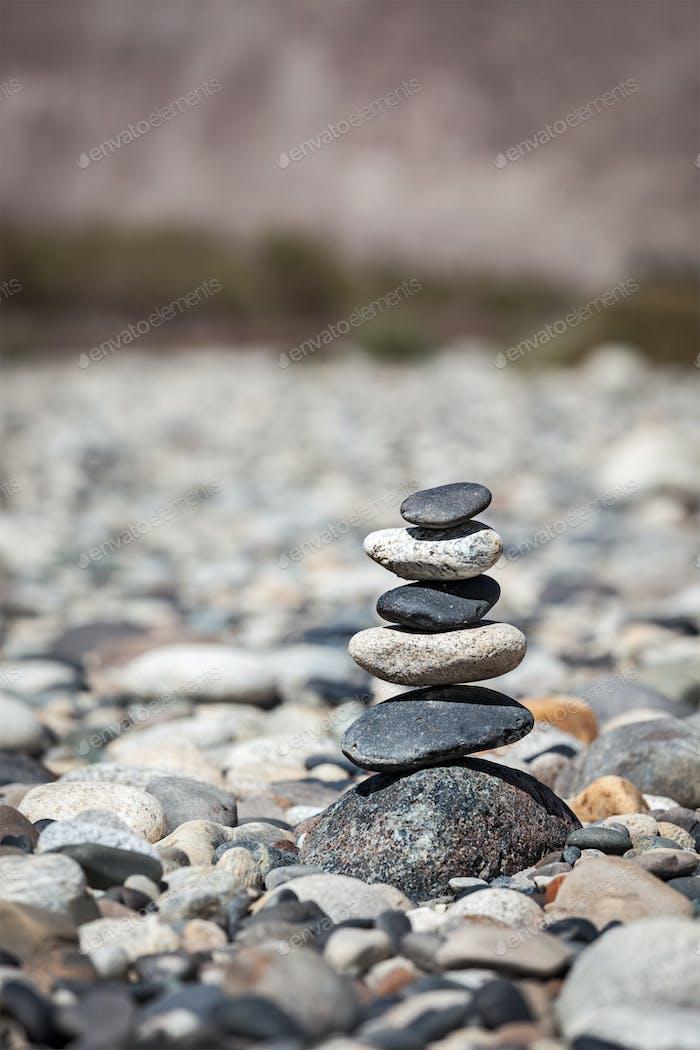 Zen balanced stones stack balance peace silence concept