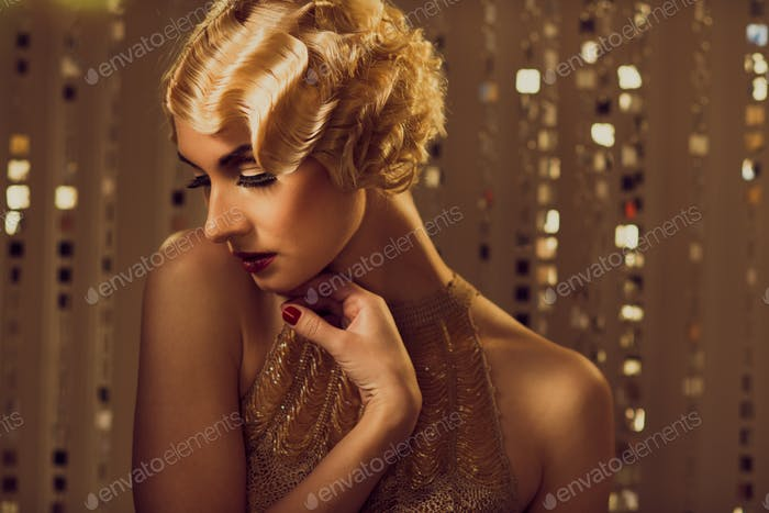 Elegant blond retro woman  in golden dress with beautiful hairdo and red lipstick