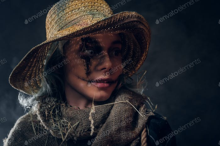 Portrait of attractive female in creepy ccarecrow role
