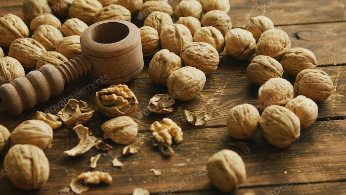 Walnuts and nutcracker on table