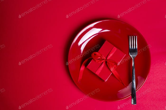 red gift box on red plate.