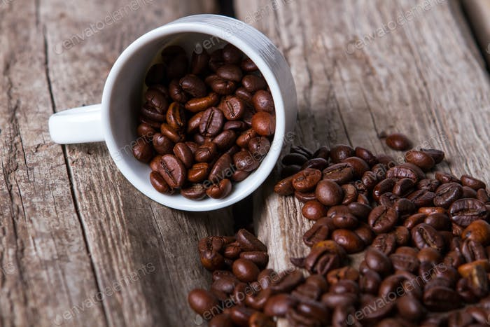Cup and roasted coffee beans