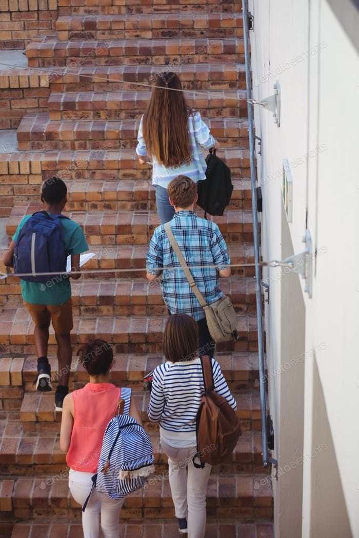 Students moving up staircase