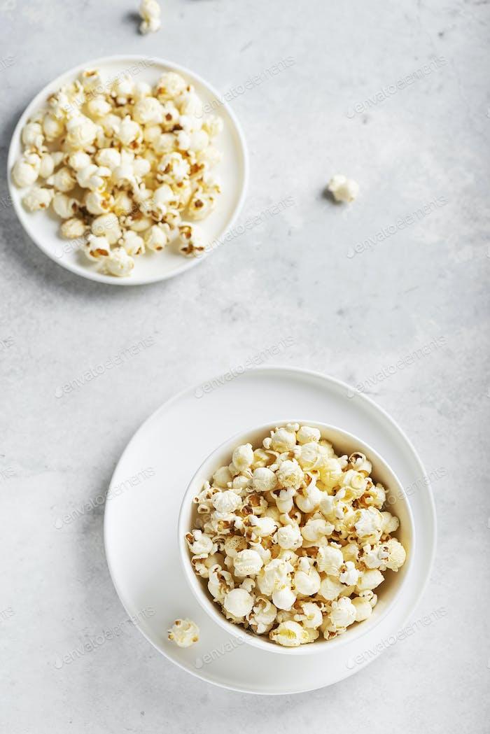 Salt popcorn in the light bowl