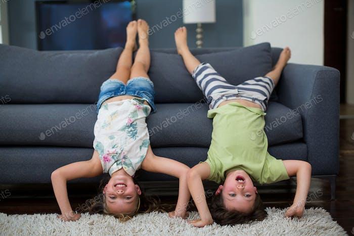 Siblings having fun in living room