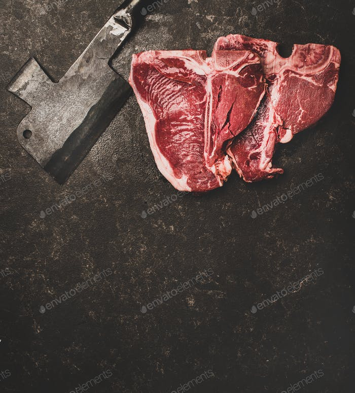Fresh uncooked beef meat t-bone steaks and cleaver, copy space