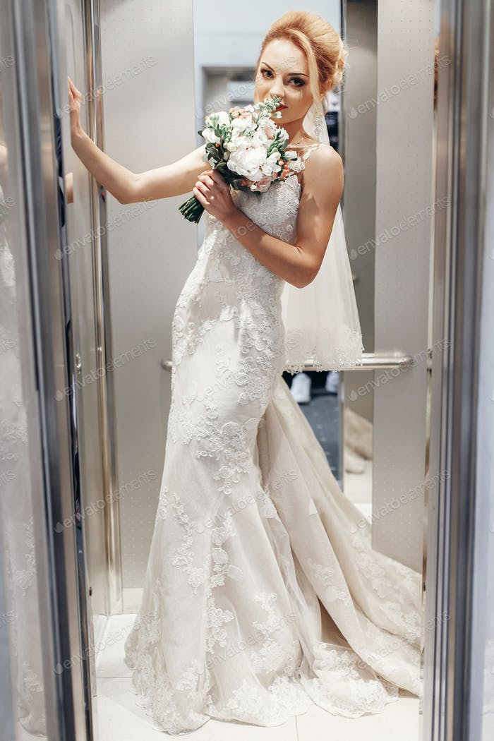 Gorgeous bride in hotel elevator