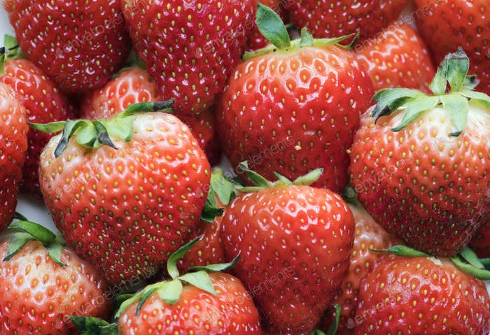 Macro of yummy strawberries background