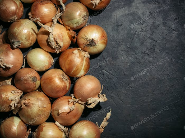 Fresh onions. Onions background. Low key