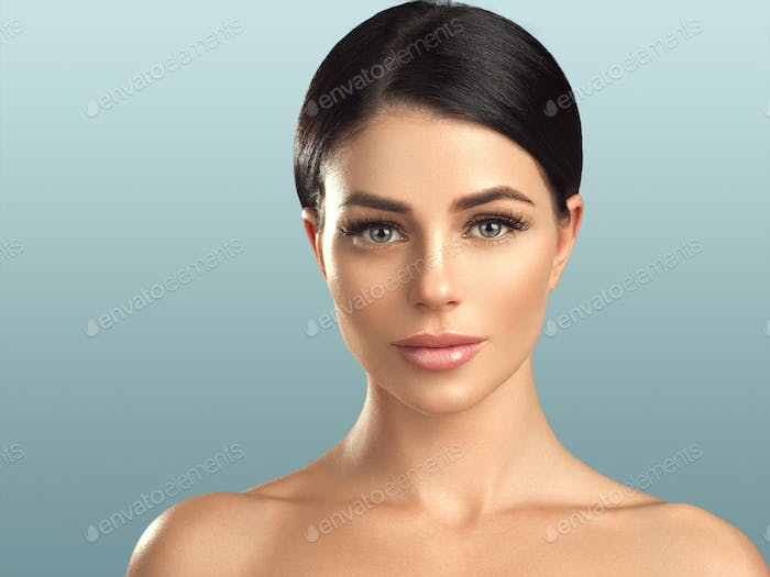 Beautiful woman healthy skin care concept portrait close up blue background. Studio shot.